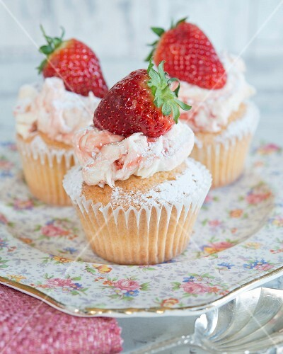 Cupcakes with strawberry cream and topped with a fresh strawberry