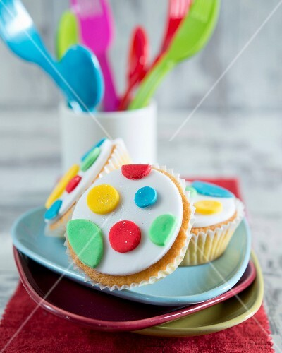 Cupcakes with colourful fondant dots