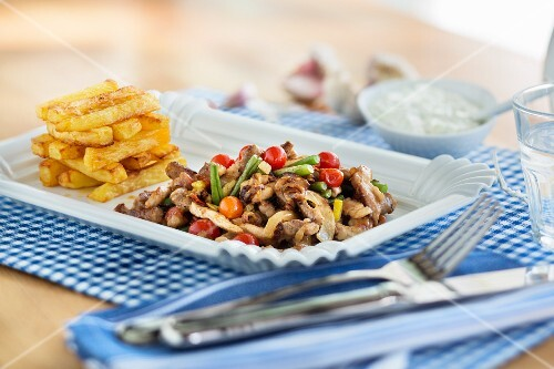 Greek-style kebab meat with chips