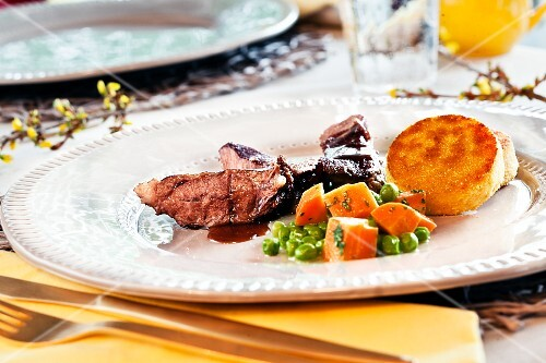 Veal cheeks with polenta and vegetables for Easter