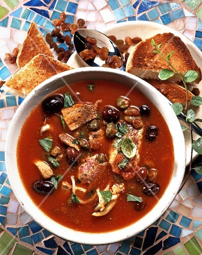 Capperata Siciliana (fish soup with tomatoes and olives, Italy)