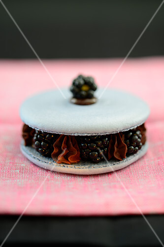 A jumbo macaroon filled with blackberries and chocolate cream
