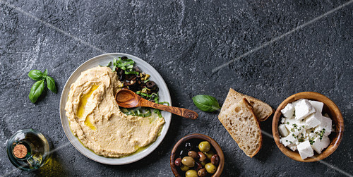 Hummus served with olives, bread and feta (seen from above)