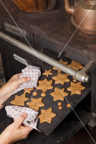 Gluten-free star-shaped nut biscuits on a baking tray
