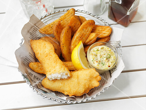 Fish and chips with a dip and lemon