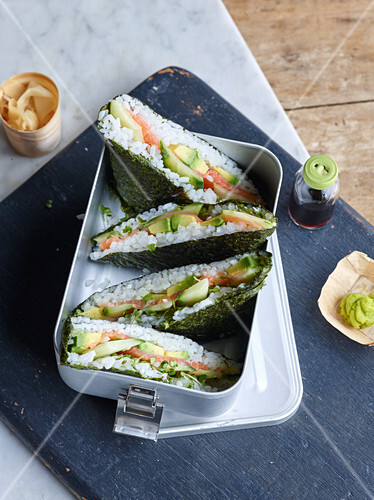 Sushi sandwiches with salmon and avocado
