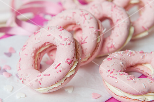 Pink macaroon doughnuts with cream cheese filling