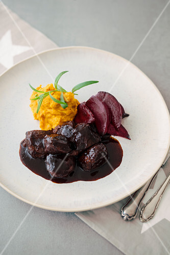 Pork cheeks with pumpkin purée and beetroot