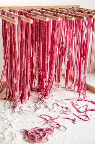 Homemade beetroot pasta drying