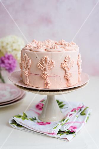 Festive vanilla cake with a pink fondant glaze