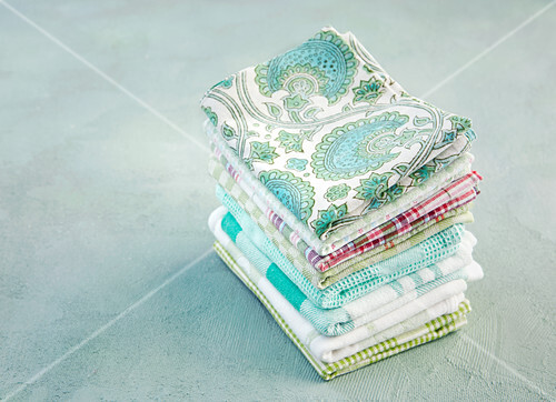 A stack of ironed and folded tea towels
