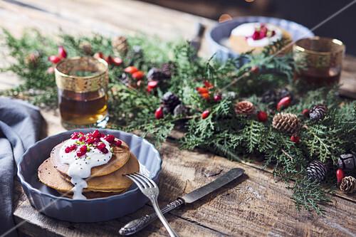 Christmas breakfast table: pumpkin pancakes with yogurt cream and currant