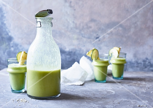 Pineapple and zucchini smoothie in a caraffe