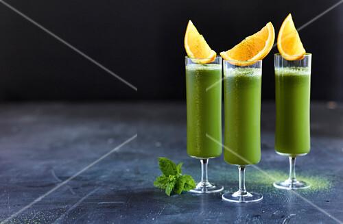 Matcha and orange lemonade with aloe vera