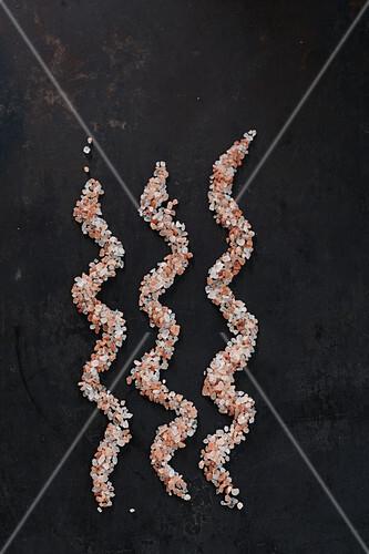 Salt arranged in three lines (artistic)