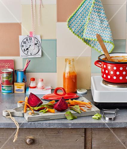 A kitchen scene – vegetables being sliced