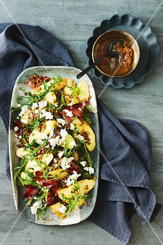 Potato salad with feta, rocket and lentils