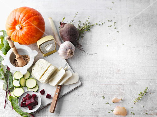 An arrangement of cheese, herbs and spices