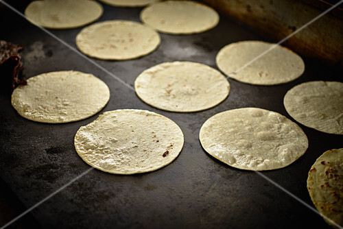 Burrito tortillas being baked