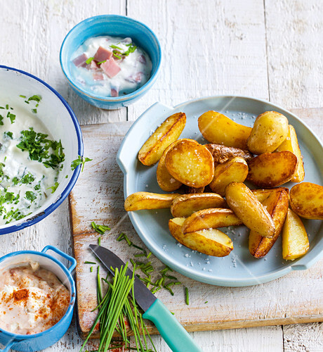 Oven-baked potato wedges with various dips
