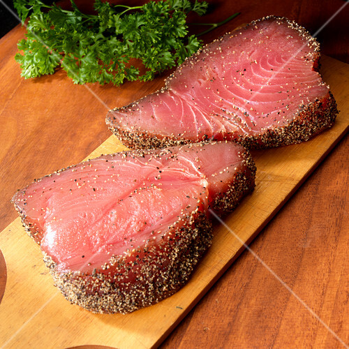 Two tuna steaks with black pepper coating