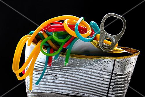 Different coloured spaghetti in a tin