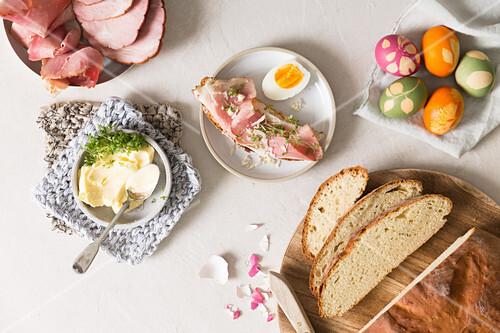 An open ham sandwich, Easter eggs, butter and cress