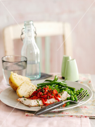 Mediterranean baked fish with vegetables and potatoes