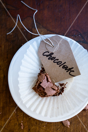 A piece of chocolate cake with a label