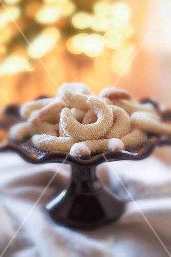 Vanilla crescent biscuits on a cake stand