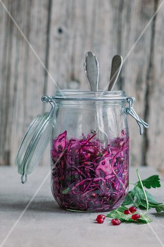 Red cabbage salad with pomegranate seeds in a jar