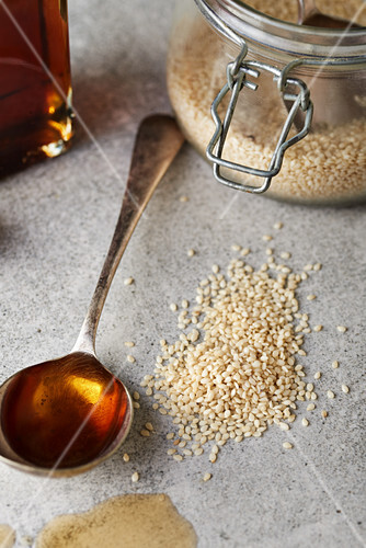 Sesame seeds and sesame oil on a spoon