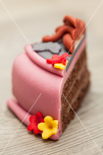 A slice of chocolate cake decorated with marzipan