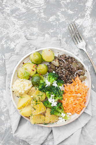 Buddha plate: Brussels srpout with chili flakes, Black lentils and fermented cucumber salad, Broccoli with feta cheese