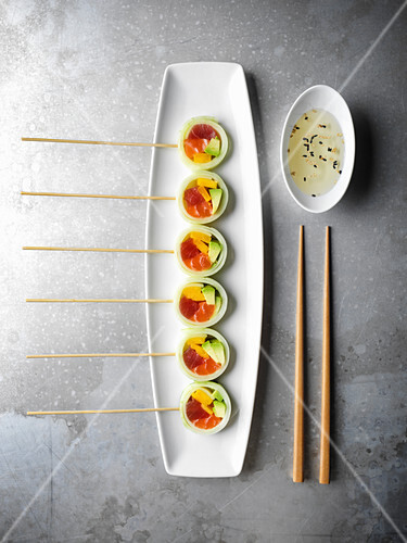 Sushi rolls on skewers to resemble lollipops