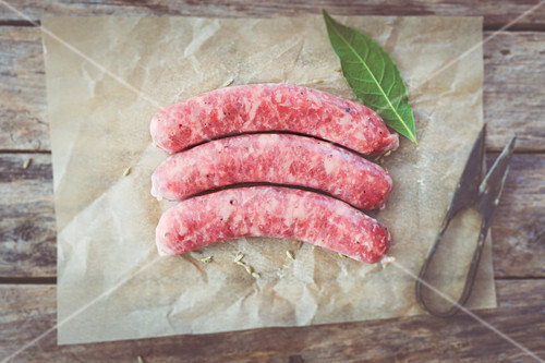 Raw salsiccia sausages with fennel on parchment paper