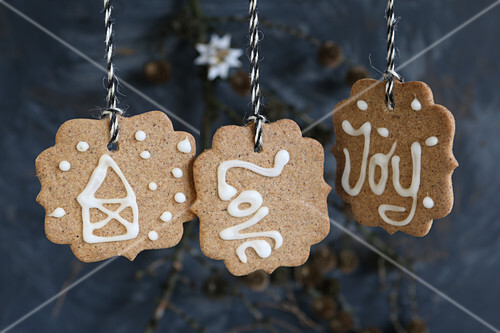 Gluten-free shortbread biscuits decorated with iced letters and pictures