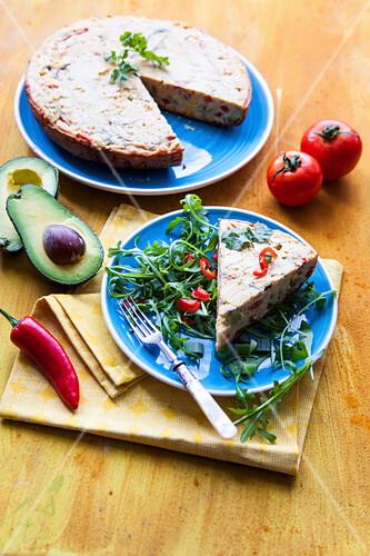 Mexican vegan farinata with avocado and tomato