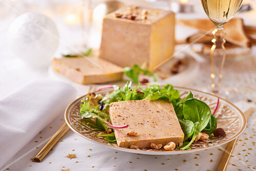 Goose liver pate with salad garnish and nuts (Christmas)