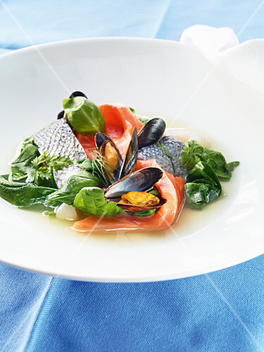 Fish soup with clear tomato stock