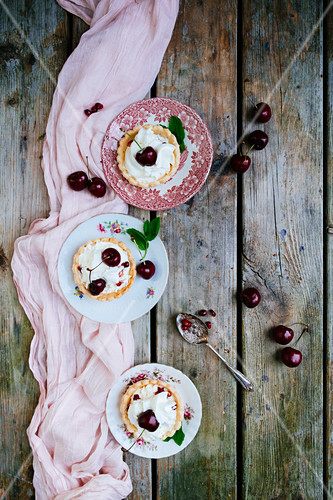 Dessert with cherries and whipped cream