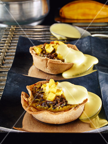 Kale and mango spelt quiche with spicy sabayon