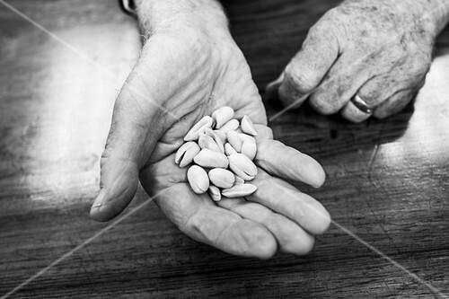Man holds peanuts