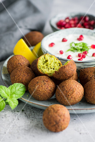 Falafel with mint yoghurt and pomegranate seeds (Arabia)