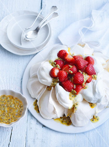 Pavlova with fresh strawberries and passion fruit