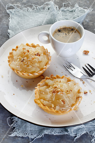 Apple tarts with walnuts, served with coffee