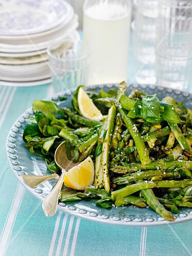Asparagus salad with green asparagus, lemons and basil