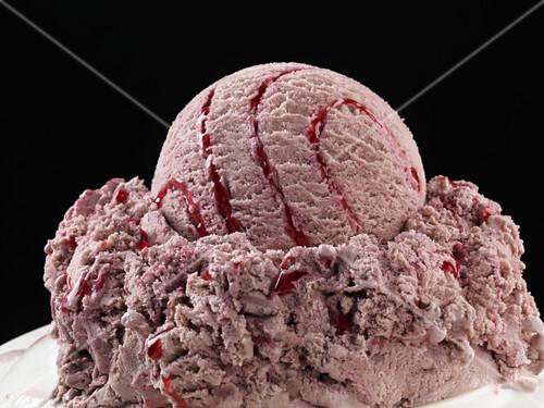 Raspberry ice cream with raspberry sauce