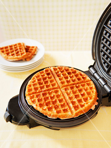 Baked waffles in a waffle iron