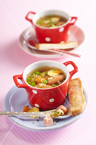 Alphabet soup with mini sausages and toast
